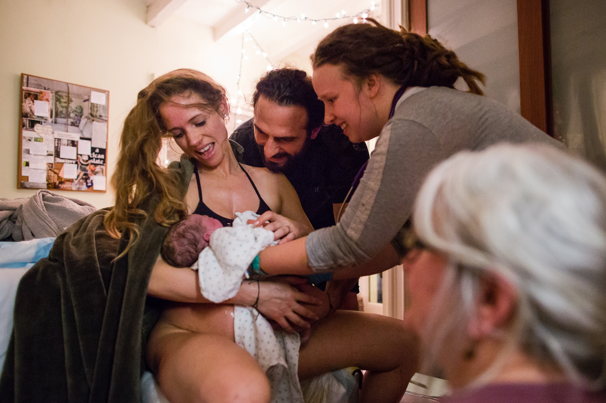 Midwife helps new mom deliver baby at home, husband and midwife support, Philadelphia Birth Photographer Rachel Utain-Evans
