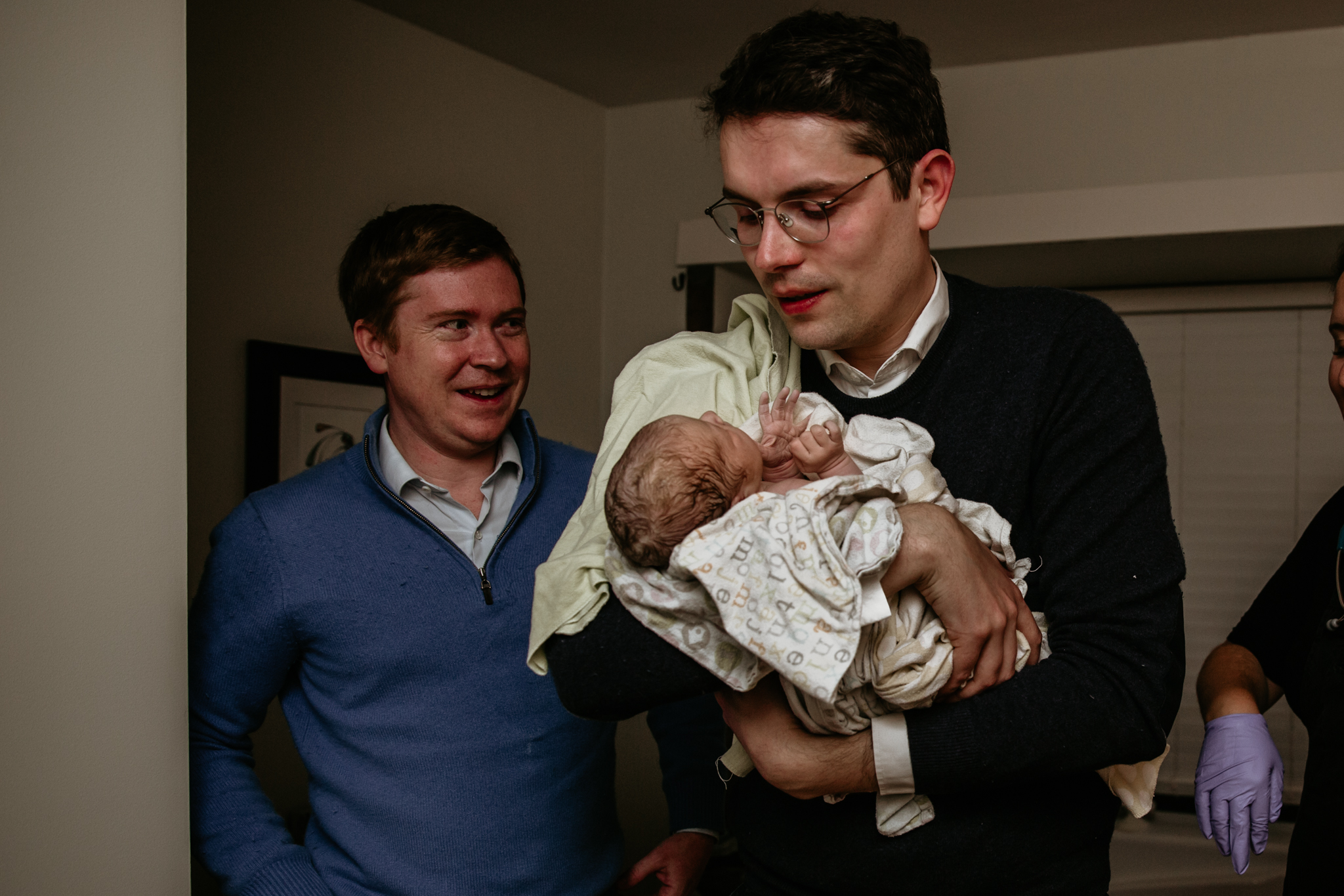 Surrogate-dad-holding-baby